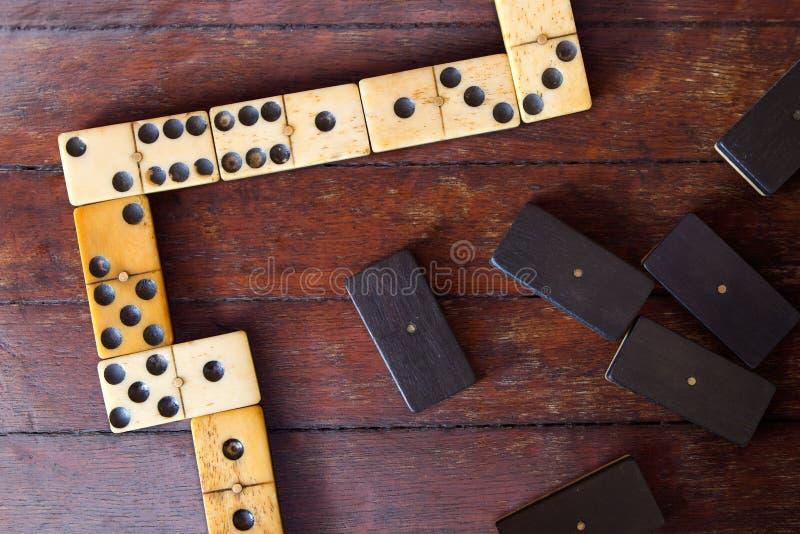 Domino dans une rangée image stock