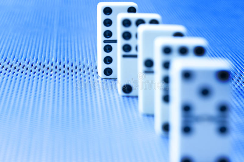Domino Dominoes Background. Dominoes in a line with selective focus royalty free stock images