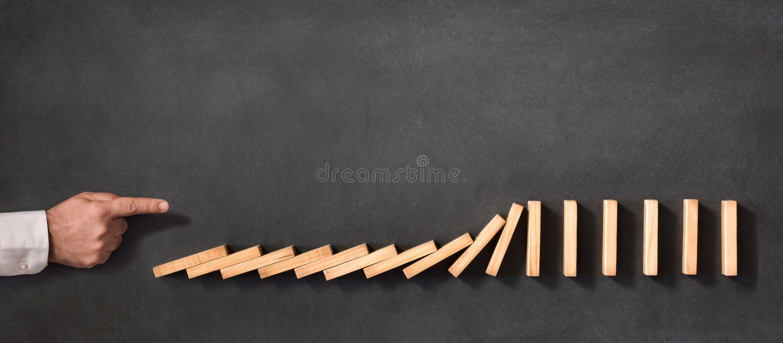 Domino Effect and Business Challenge Concept stock image