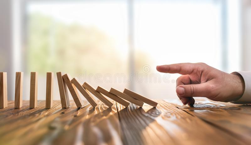 Domino Effect. Just Starting or Triggering Business Process stock photography