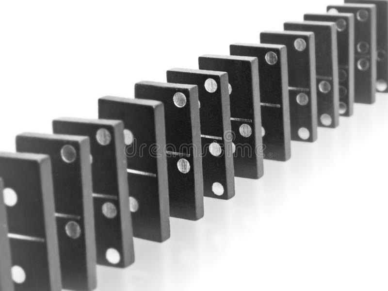 Domino effect. Row of domino tiles symbolizing fragile system stock photos