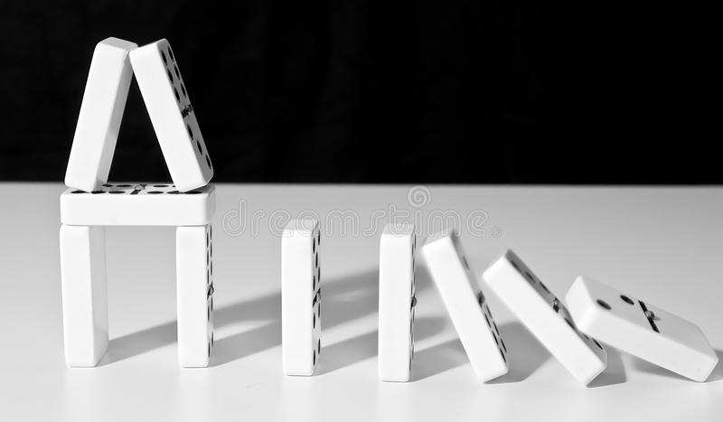 Domino house falling royalty free stock images