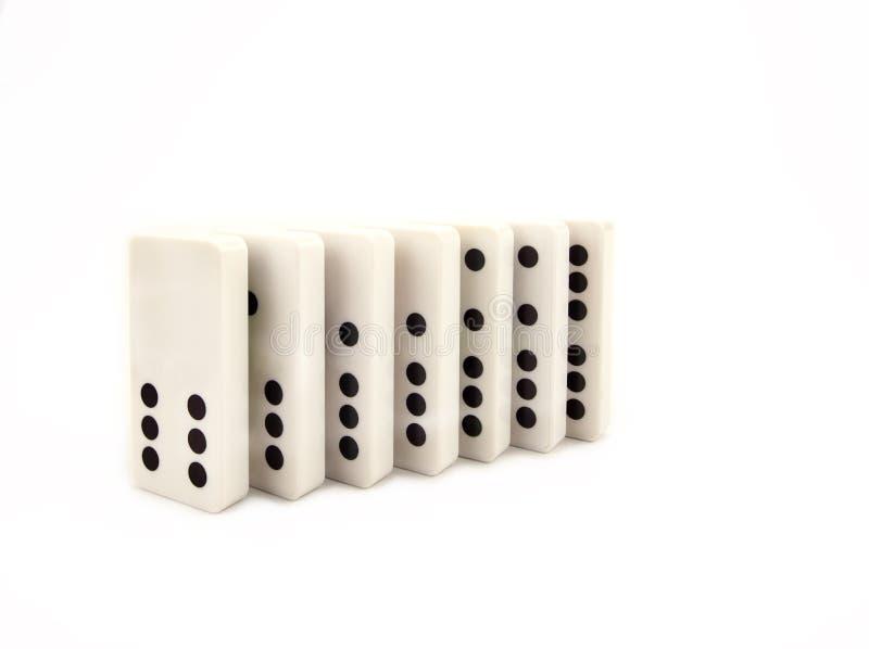 Domino op een witte achtergrond wordt geïsoleerd die stock afbeelding
