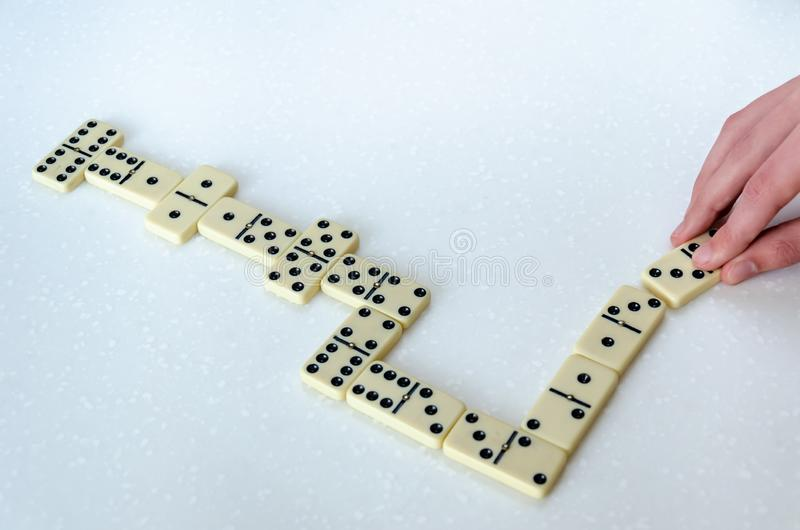 Domino på vit bakgrund arkivbild