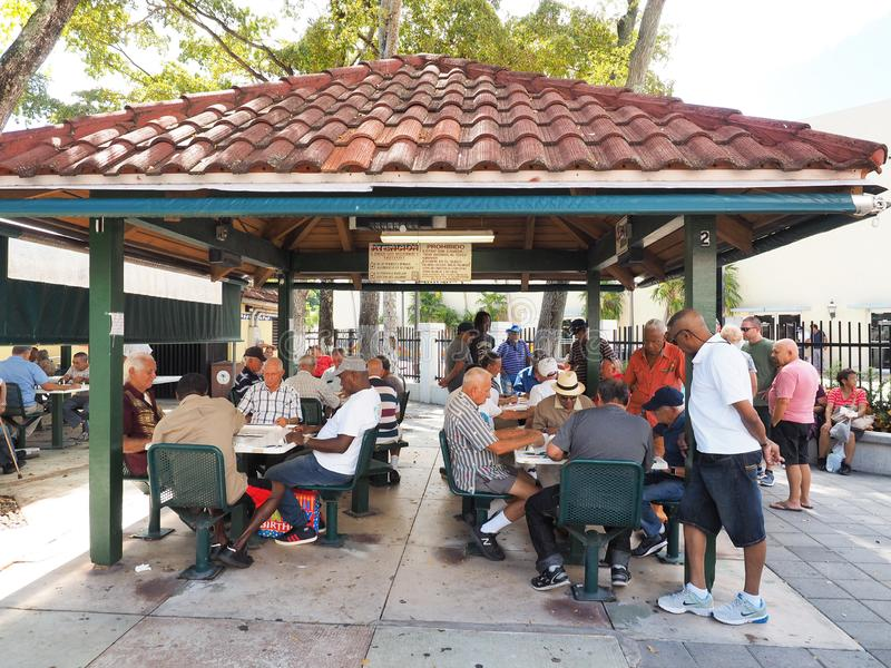 Domino Park on Calle Ocho in Little Havana, Miami, Florida. Miami, Florida 10-21-2018 Senior Cubans gather at Domino Park on Calle Ocho - Eigth Street - in royalty free stock images