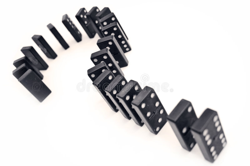 Domino question mark. Question mark made from dominoes balanced on end royalty free stock image