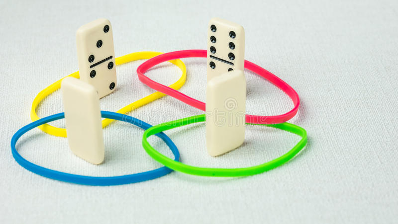 Domino represent human teams with different psyhological traits based on DISK model. Dominance, inducement, submission. And compliance and cooperation royalty free stock photography
