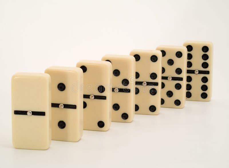 Domino som staplas i numerisk beställning royaltyfri foto