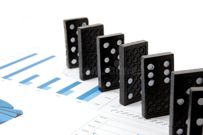 Domino sul diagramma fotografia stock