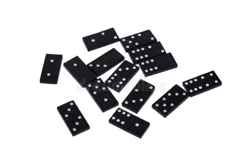 Dominochips mit den verschiedenen Zahlen zerstreut auf einen weißen Hintergrund isolat stockbild