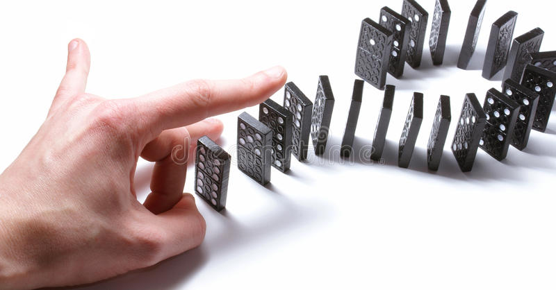 Download Dominoe Pieces Pushed By A Human Hand Stock Image - Image: 14652513