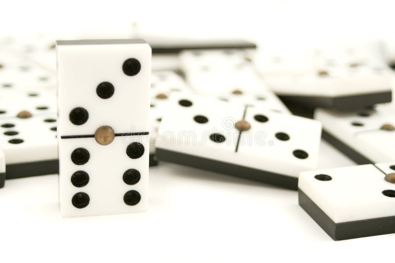 Dominoes. Lined up white dominoes with black dots stock photos