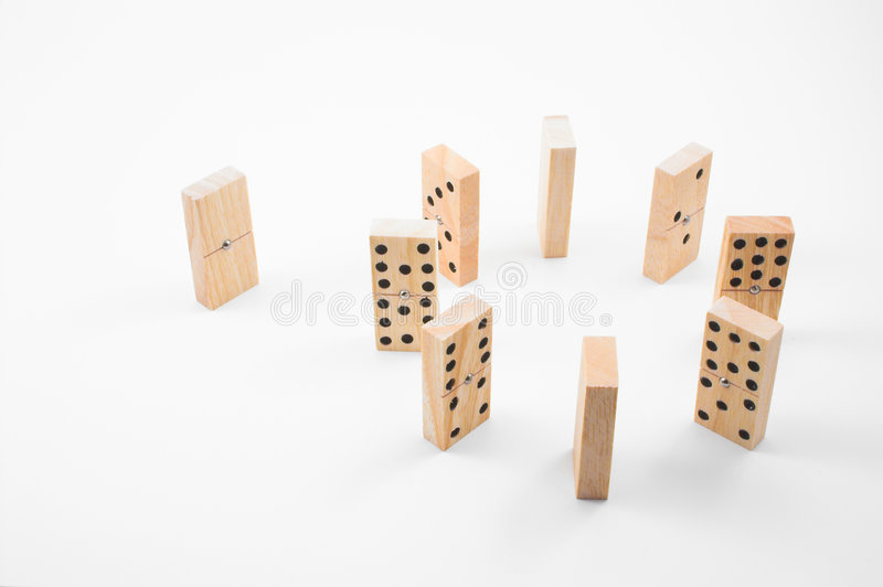 Dominoes. Handmade wooden dominoes in a circle configuration - a concept of being an outcast or unaccepted stock image