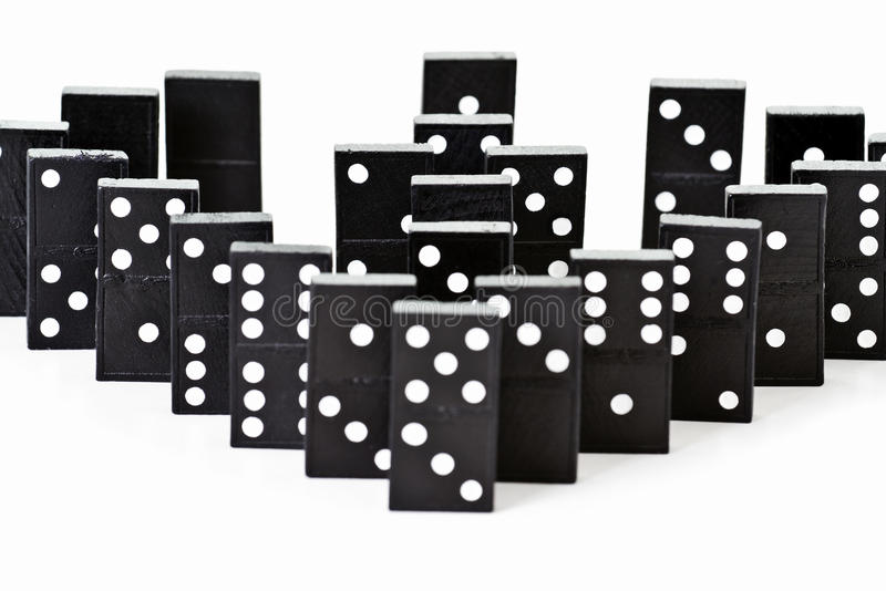 Dominoes. Stack of dominoes on a white background royalty free stock photos