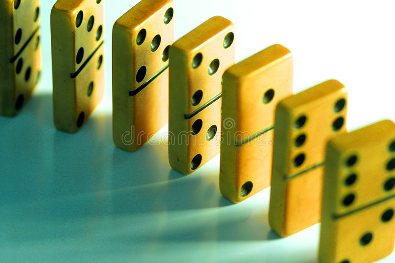 Dominoes. Lined up waiting to fall stock photo
