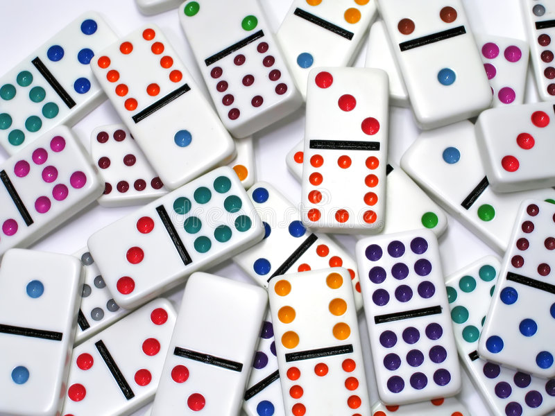 Dominoes. Scattered dominoes isolated on white stock photos