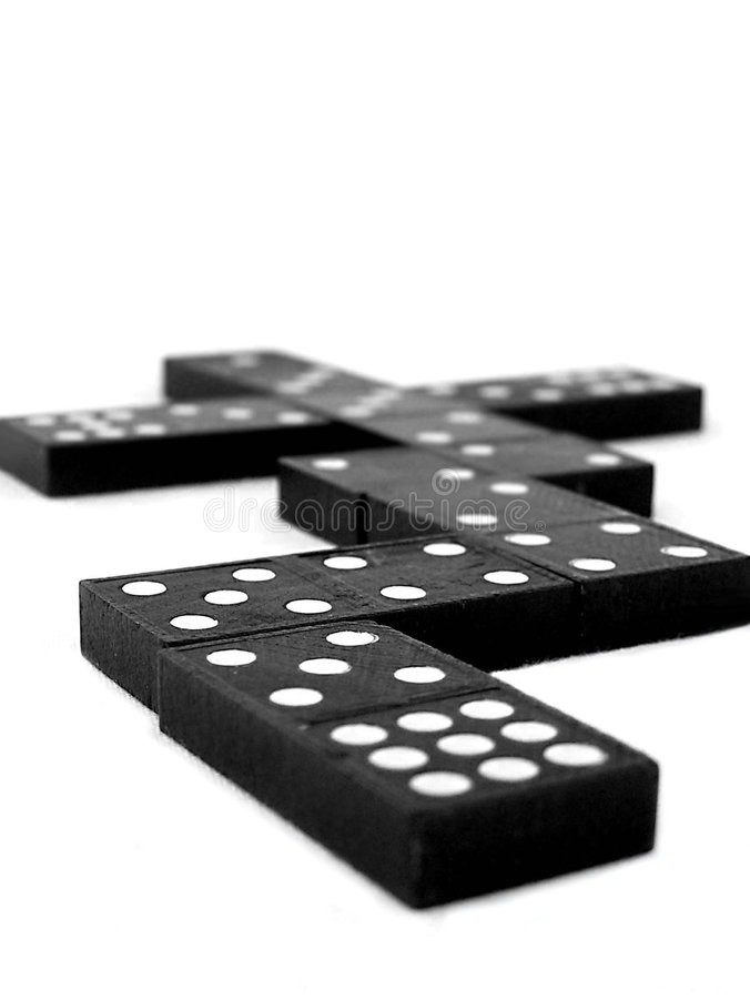 Dominoes. Black dominoes photographed on white background stock image