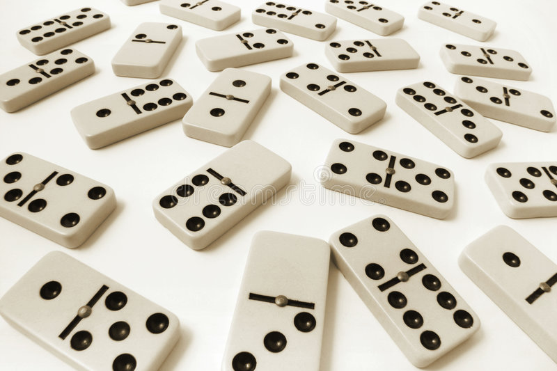 Dominoes. Multiple Dominoes on Seamless Background royalty free stock image