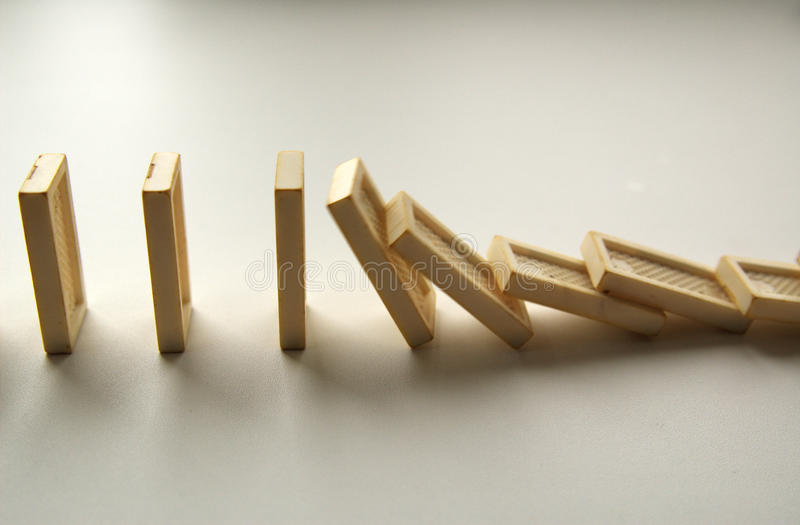 Dominoes. Fallen dominoes freezed moment of time royalty free stock images