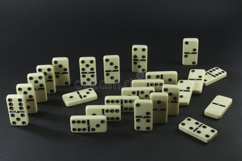 Dominoes. On a black background stock images