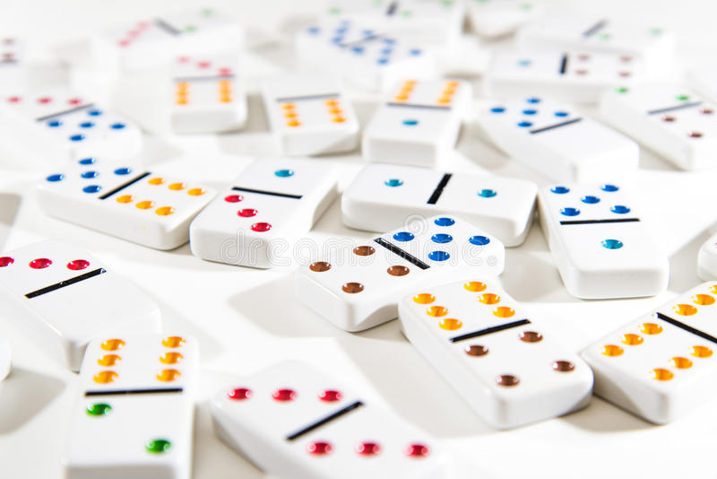 Dominoes Scattered on White royalty free stock image