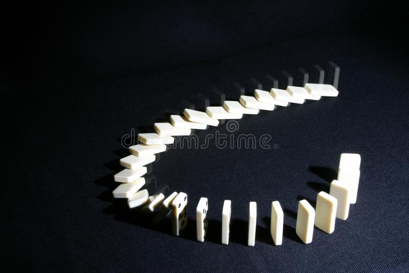 Dominoes in two stages stock photos