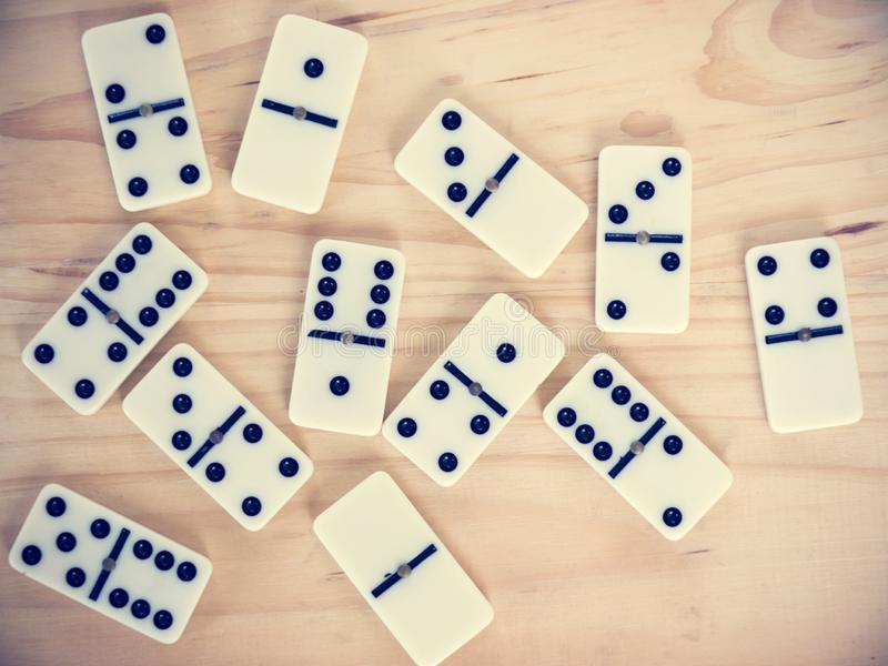 Dominoes on wooden table stock photos