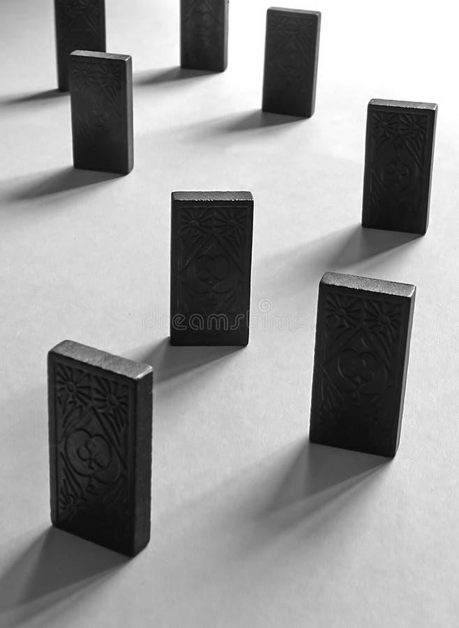 Dominos Contre éclairés Photographie stock libre de droits