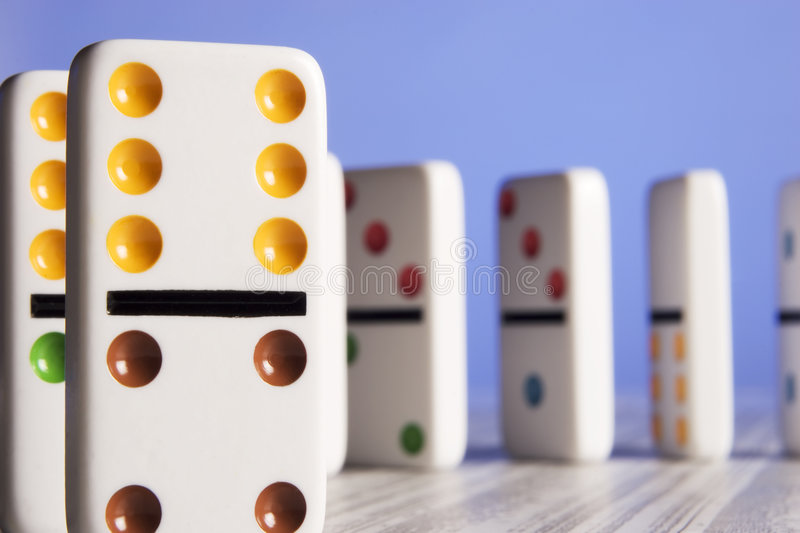 Dominos and stock report. Dominos placed on a stock report stock photo