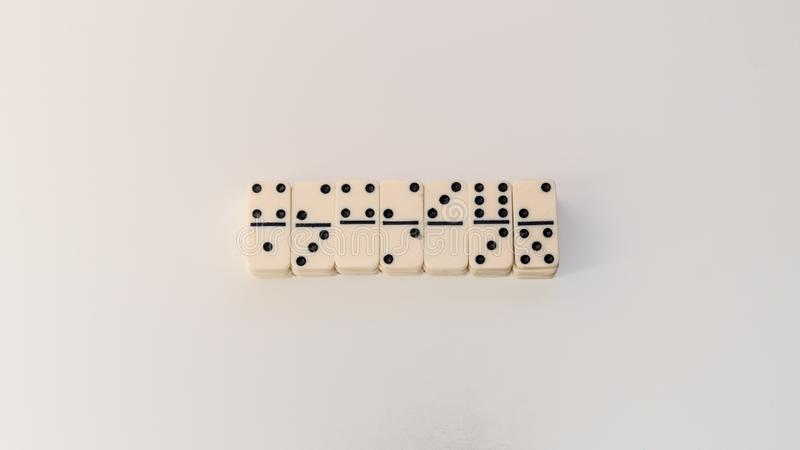 Dominospel op witte achtergrond stock afbeelding