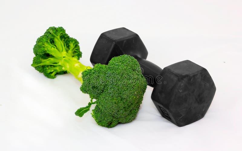 Domoor die van Broccoli op witte achtergrond wordt gemaakt. Nadruk vooraan. royalty-vrije stock afbeelding