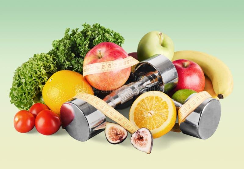 Domoren met het meten van band, groenten en stock foto