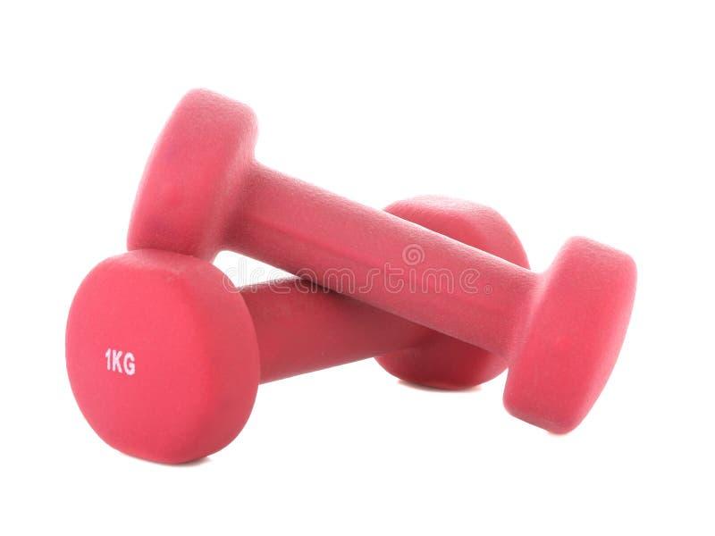 Domoren voor geschiktheids roze kleur op een wit geïsoleerde achtergrond Sportmateriaal stock foto's