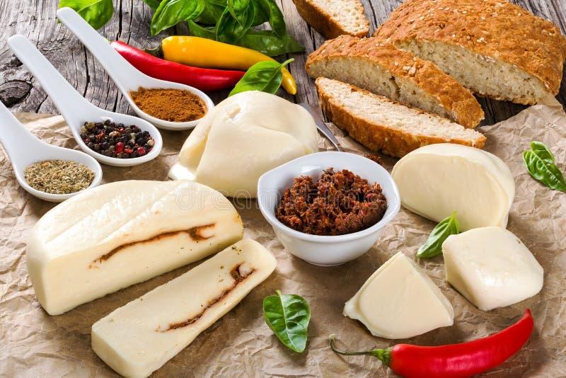 Domowej roboty mozzarelli pełnia ściśle z adjika lub czerwieni pesto zdjęcia stock