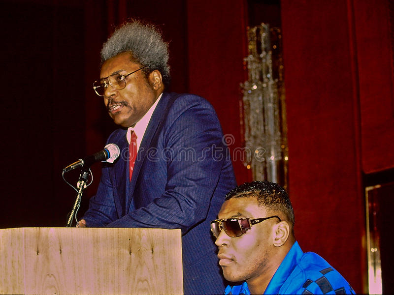 Don King and Mike Tyson. Boxing Legend Don King speaks at a press conference with a young Mike Tyson (image scanned from slide stock image