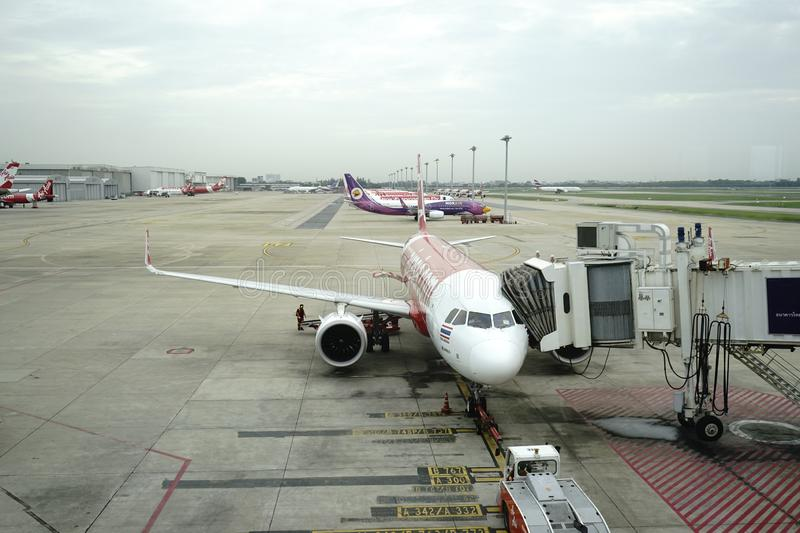 Don Meung airport in Bangkok, Thailand. There are many low cost airlines operate here. Air Asia is one of the famous low fare carriers. From waiting rooms, we stock photography