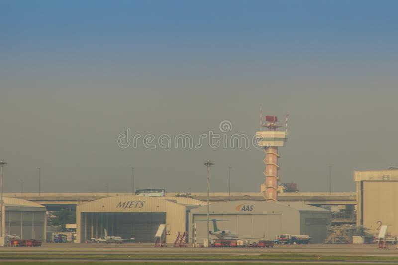 Airplane control tower on the field with blue sky background at Don Muang International Airport, Thailand. stock image