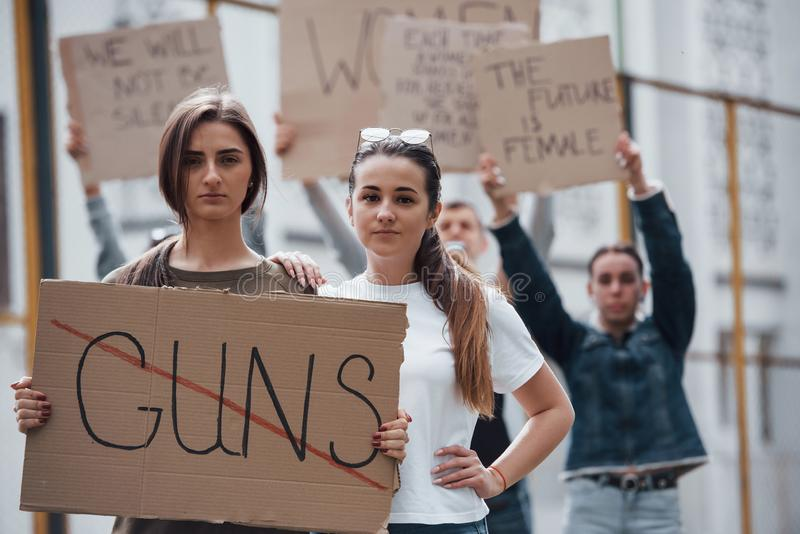 We don`t allow weapons. Group of feminist women have protest for their rights outdoors.  stock photos