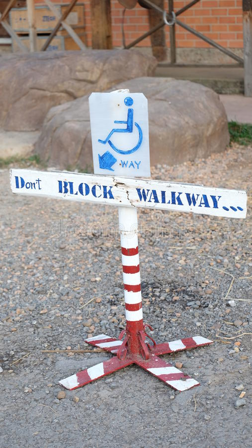 Don't block The way for cripple. stock images