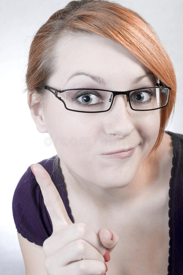 Don't do it. The young woman points a finger gesticulation stock photos