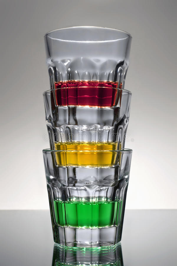 Don't drink and drive. Three shot glasses with alcohol stacked to form a traffic light royalty free stock photos