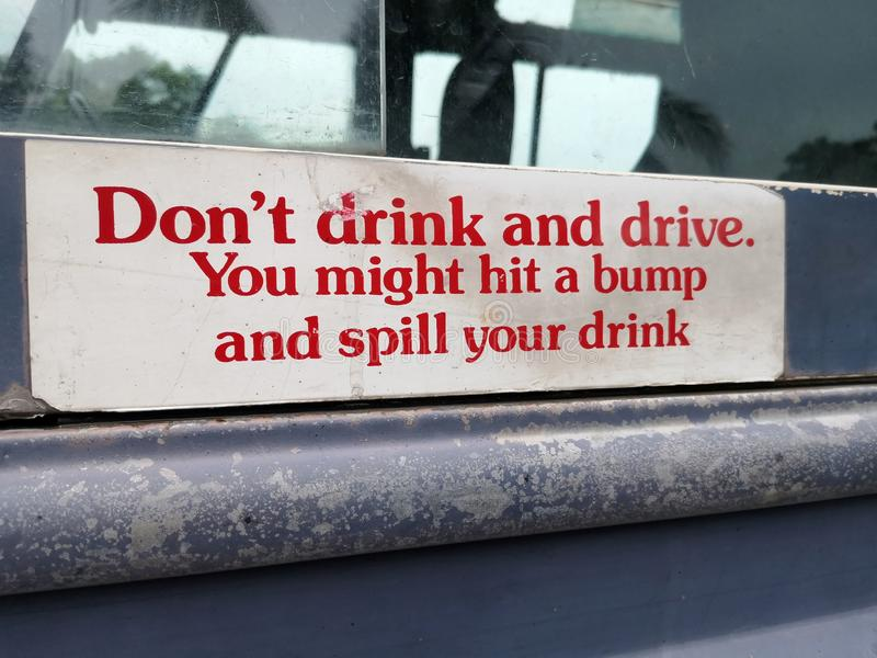 Don`t drink and drive. You might hit a bump and spill your drink. stock photos