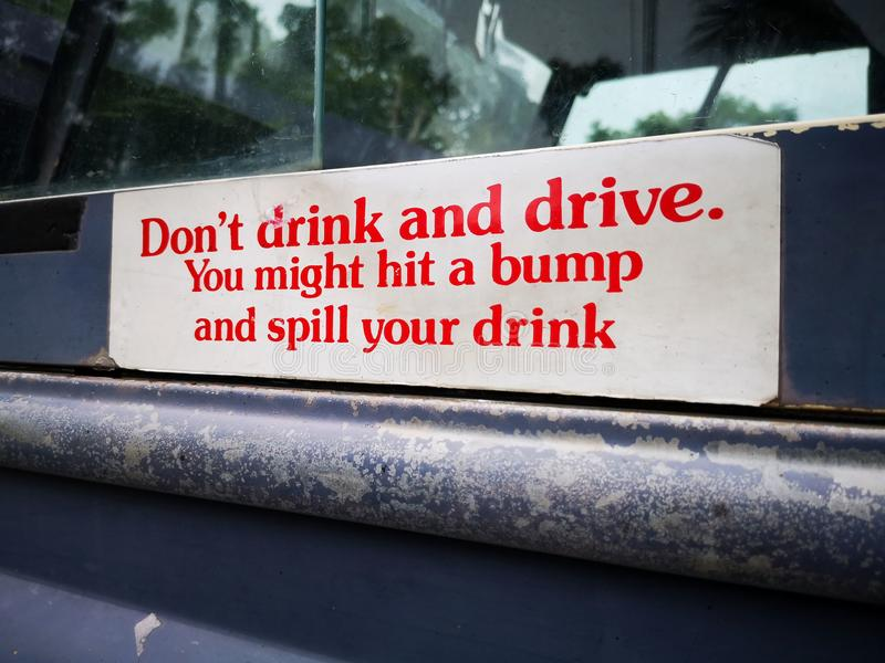 Don`t drink and drive. You might hit a bump and spill your drink. royalty free stock image