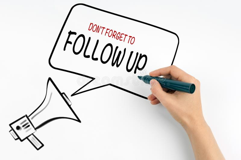 Don`t Forget to Follow Up. Megaphone and text on a white background stock images