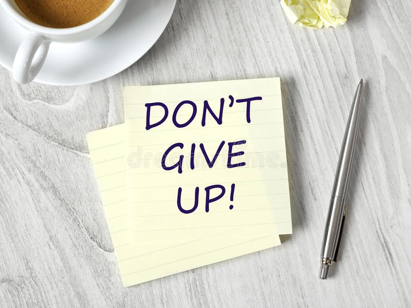 Don`t give up. Message on adhesive note stock photography