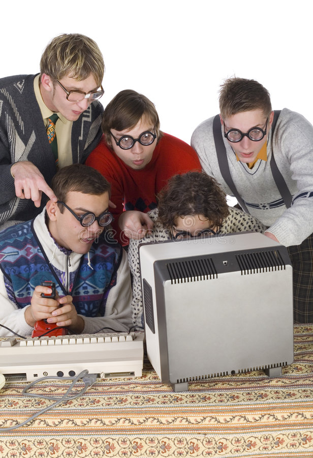 Don't go there!. Five nerdy guys sitting and standing in front of old-fashioned computer. They are looking surprised to mointor. One of them is holding joystick stock photo