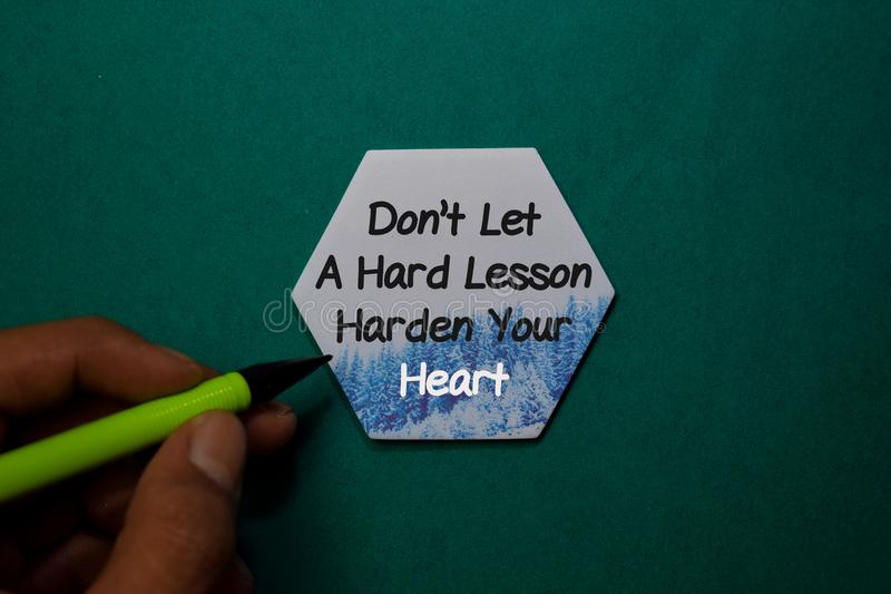 Don`t Let A Hard Lesson Harden your Heart write on stick note isolated on Office Desk stock photo