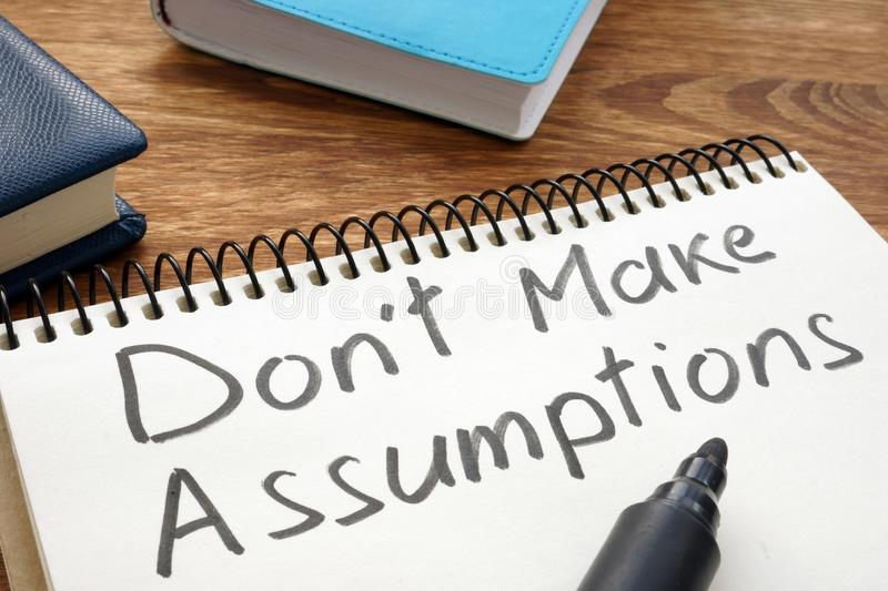 Dont Make Assumptions. Notepad with marker on a table royalty free stock photography