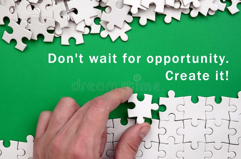 Don& x27;t wait for opportunity. Create it. The hand folds a white ji stock photos