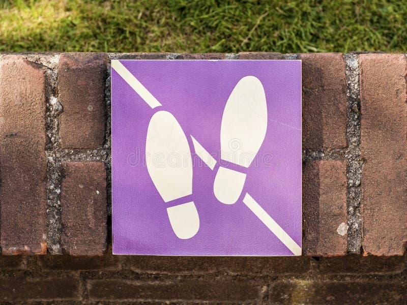 Don't walk on the grass sign. In Begijnhof, Amsterdam stock image